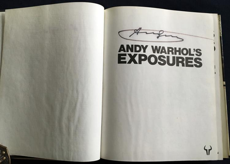 ANDY WARHOL's Exposures Signed by Andy Warhol in black marker.