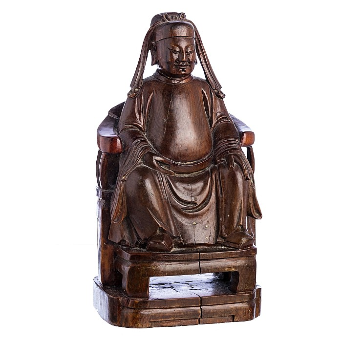 Wooden sculpture of a dignitary