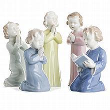 Five sculptures 'Pequenos Cantores da Vista Alegre' (Little singers of Vista Ale