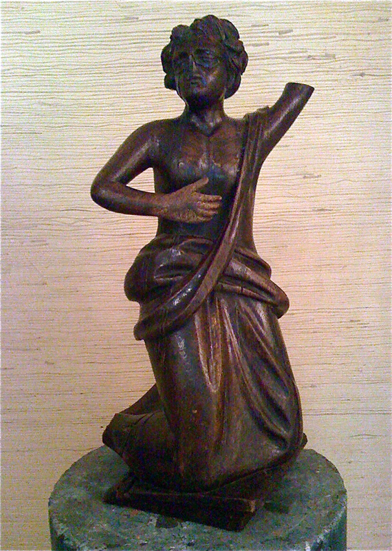 Wooden Saint sculpture