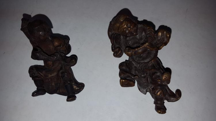 Pair of Figural Scroll Weights