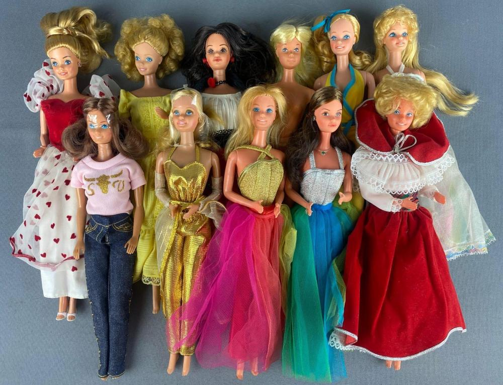 Group of 11 assorted Barbie Fashion Dolls and more