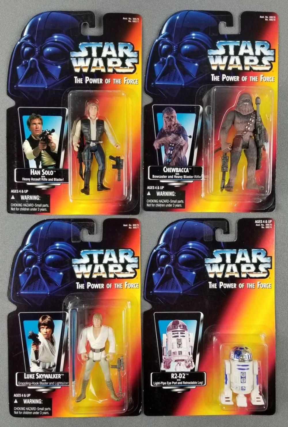 Group of 4 Star Wars action figures in original packaging