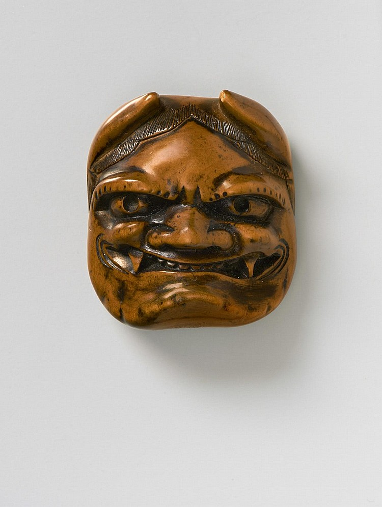 a japanese mask netsuke of oni with okame behind  late 18th