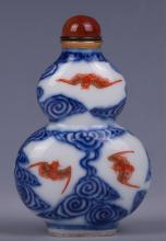 CHINESE BLUE AND WHITE WITH IRON RED SNUFF BOTTLE