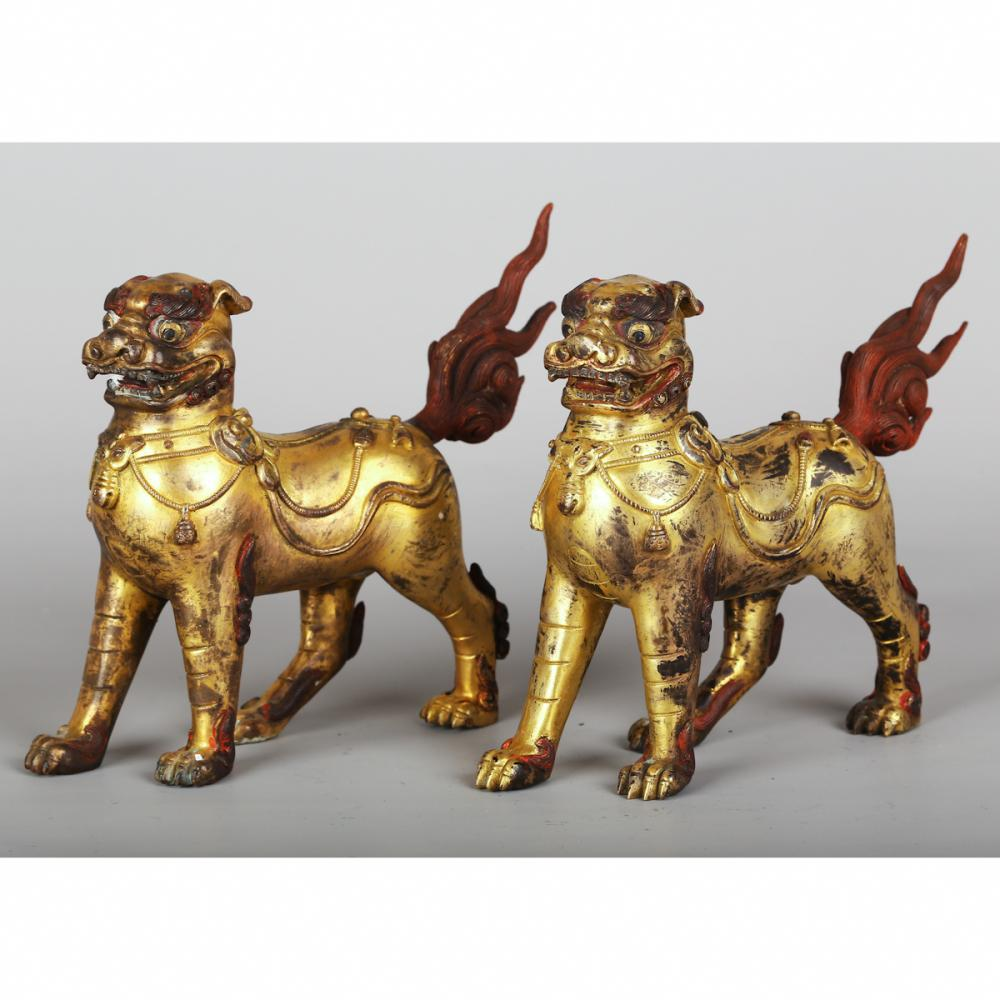 CHINESE PAIR OF GILT BRONZE FOO DOGS