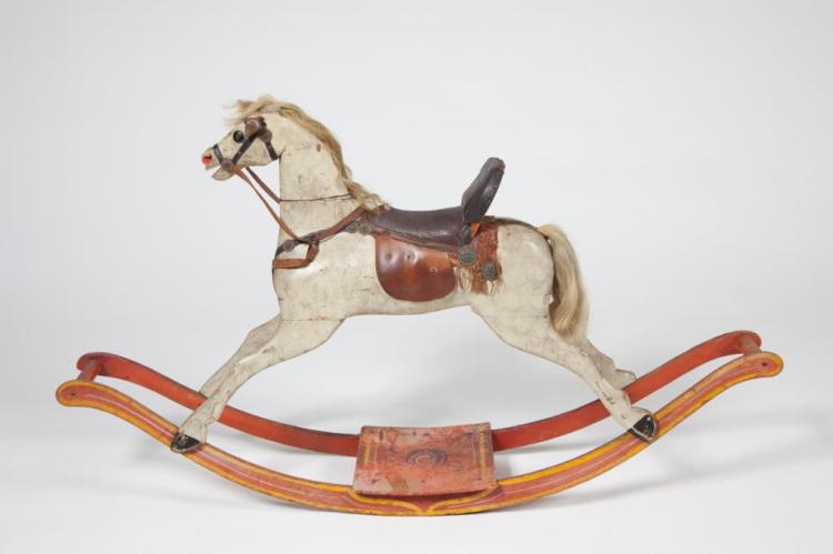 EARLY CARVED AND PAINTED WOOD ROCKING HORSE