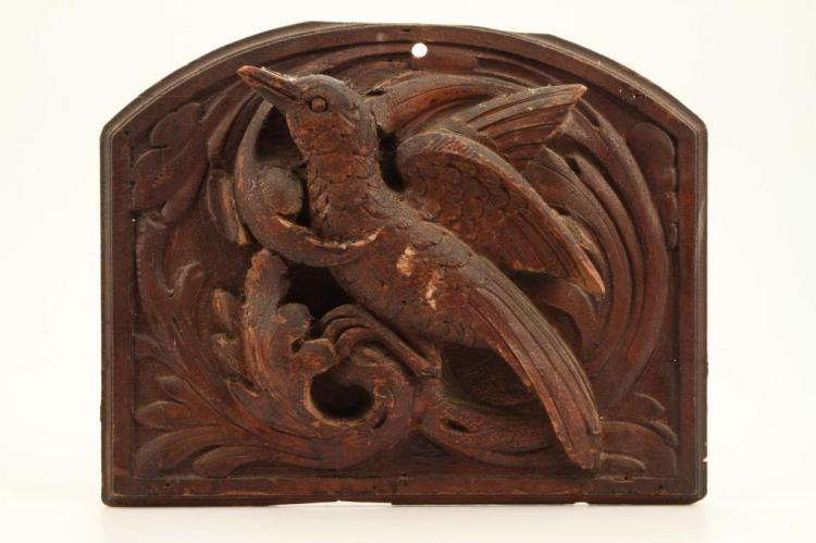 High relief carved panel of bird in branches