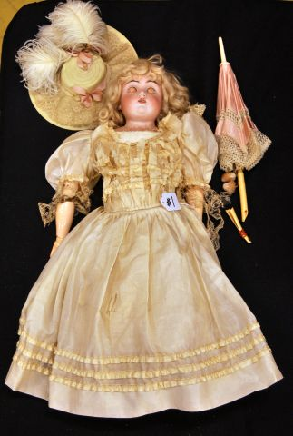 "20"" Bisque shoulder head doll with hat and parasol, marked DEP.8-154"