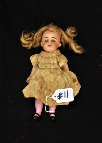 "7 1/2"" five piece bisque doll marked 150, sleep eyes, open mouth"