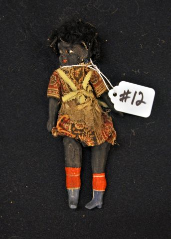 "6 1/2"" Black doll wood and composition, glass eyes, painted body"