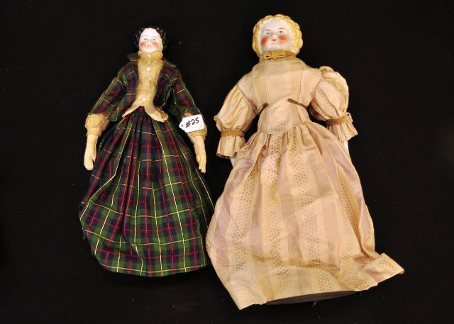 "Two dolls, a 17"" shoulder head high brow doll and a blonde curly top shoulder head with cloth body"