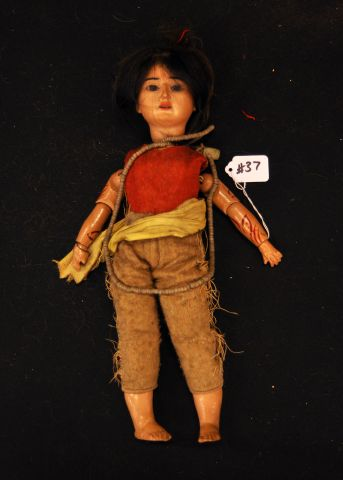 "16"" Bisque head Indian character doll, wooden arms, composition feet, felt clothing, paint decoration to the arms, body marked 4 1/2"