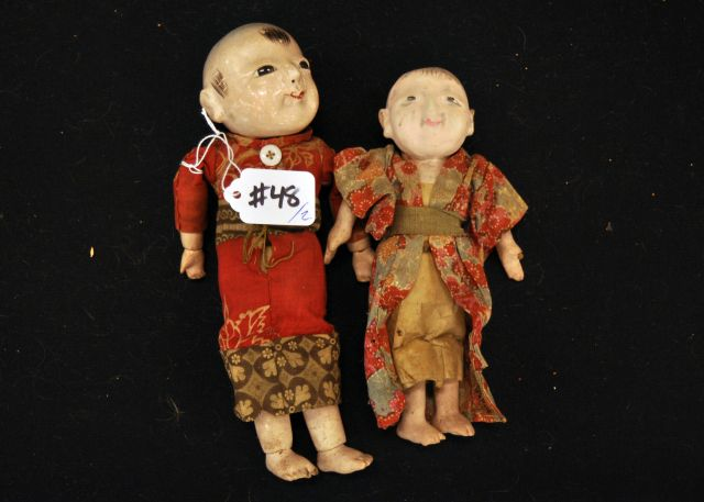 "Lot of two dolls, 9"" and 7"" both composition Chinese dolls one with a glass eye"