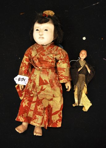 "Lot of two dolls, 14"" and 7"" Chinese lady, composition head arms and legs and Chinese man, composition head arms and feet"
