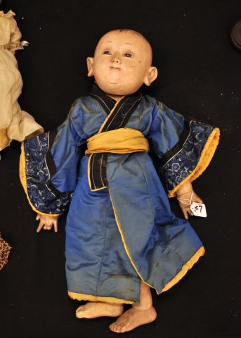 "24"" Chinese baby doll, composition with glass eyes"