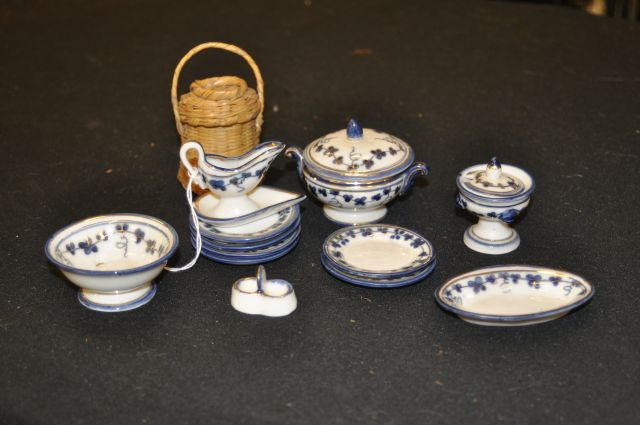 12 piece doll tea set and small basket, tallest piece is 3""