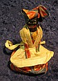 31. Racist Art and black memorabilia Female figure on a Dinner Bell dressed in Hatian Costume.