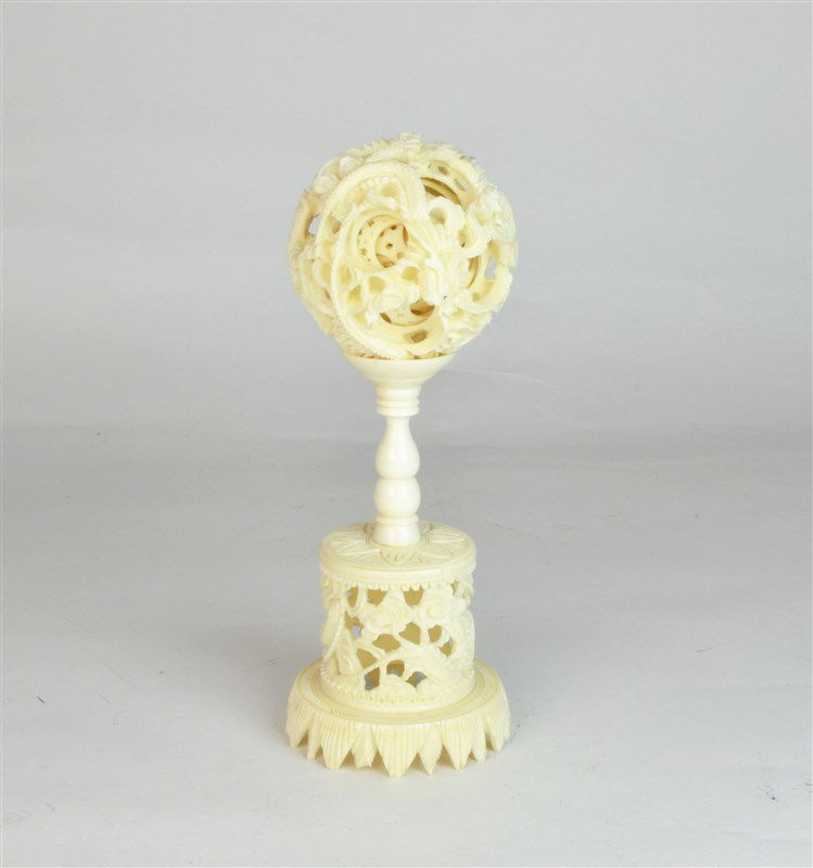 A chinese carved ivory puzzle ball with stand