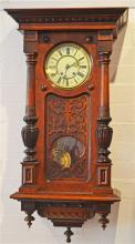 A Mahogany Case Chiming Wall Clock