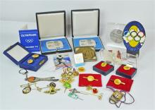 A Large Collection of Olympic Badges, Medallions,