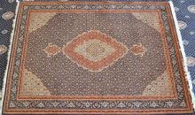 A Persian Tabriz Wool Floor Rug