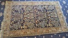A Fine Weave Persian Wool and Silk-inlay Rug
