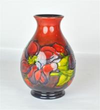 A Walter Moorcroft Pottery Flambe Clematis Vase
