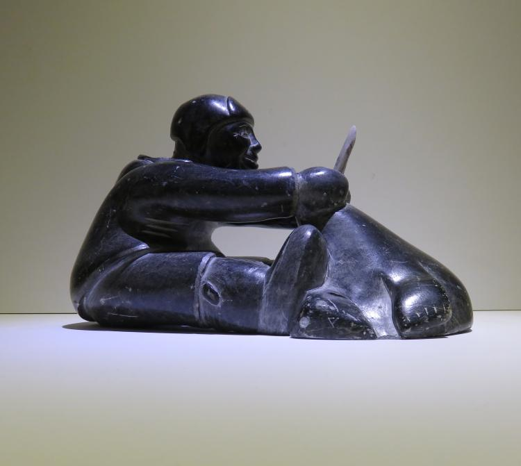 Hunter with Walrus - sculpture