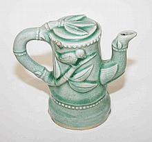 A CHINESE GREEN CRACKLEWARE TEA POT FORM WATER