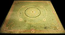 A FINE LIME GREEN DONGEGAL HAND KNOTTED CARPET,