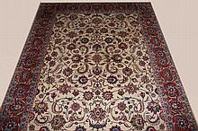 A VERY ATTRACTIVE ORIENTAL CARPET, the ivory field