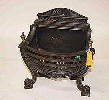 A HEAVY CAST IRON BOW FRONTED BASKET GRATE, with