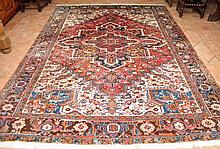 A PERSIAN KNOTTED CARPET, from the Heriz region,