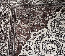A CREAM AND BROWN GROUND TABRIZ CARPET, with large