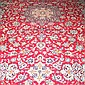 A PERSIAN KNOTTED CARPET, the red ground with a