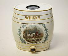 AN OVAL SHAPED PORCELAIN WHISKEY BARRELL with