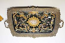 A BRASS MOUNTED TWO-HANDLED PORCELAIN DISH, with