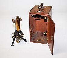 A BRASS AND STEEL LABORATORY MICROSCOPE, by E