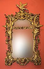 A FINE IRISH CARVED GILTWOOD WALL MIRROR, in the