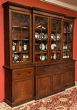 A WILLIAM IV PERIOD MAHOGANY BREAKFRONT SECRETAIRE