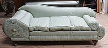 AN UNUSUAL CHAISE LONGUE, covered in green fabric