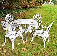 A FIVE PIECE SET OF PATIO OR GARDEN FURNITURE,  comprising four armchairs,