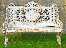A PAIR OF VERY HEAVY CAST IRON GARDEN SEATS,  each with a pierced back, the