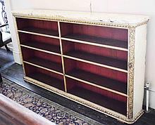 A 19TH CENTURY CREAM PAINTED AND PARCEL GILT OPEN BOOKCASE,  with six shelv
