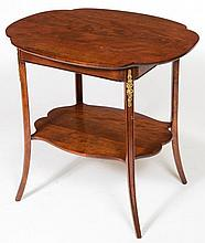 A 20TH CENTURY QUATREFOIL SHAPED BEECH AND MAHOGANY ETAGÉRE,  with brass mo