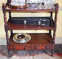 AN EARLY VICTORIAN RECTANGULAR THREE TIER MAHOGANY DUMB WAITER,  with turne