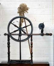 A 19TH CENTURY PINE AND ELM FOOT OPERATED SPINNING