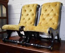 A PAIR OF LATE VICTORIAN EBONISED AND BRASS BOUND