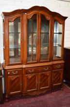 A FRENCH WALNUT DISPLAY CABINET,  with shaped and